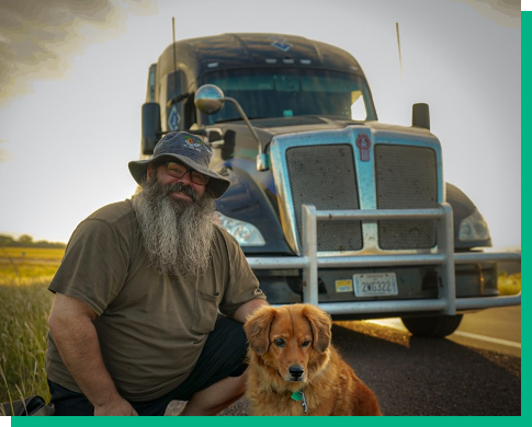 man with dog in front of lease-to-own truck